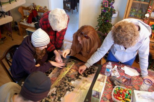 The Jennings girls and The Man obsess over a really bad Thomas Kinkade puzzle
